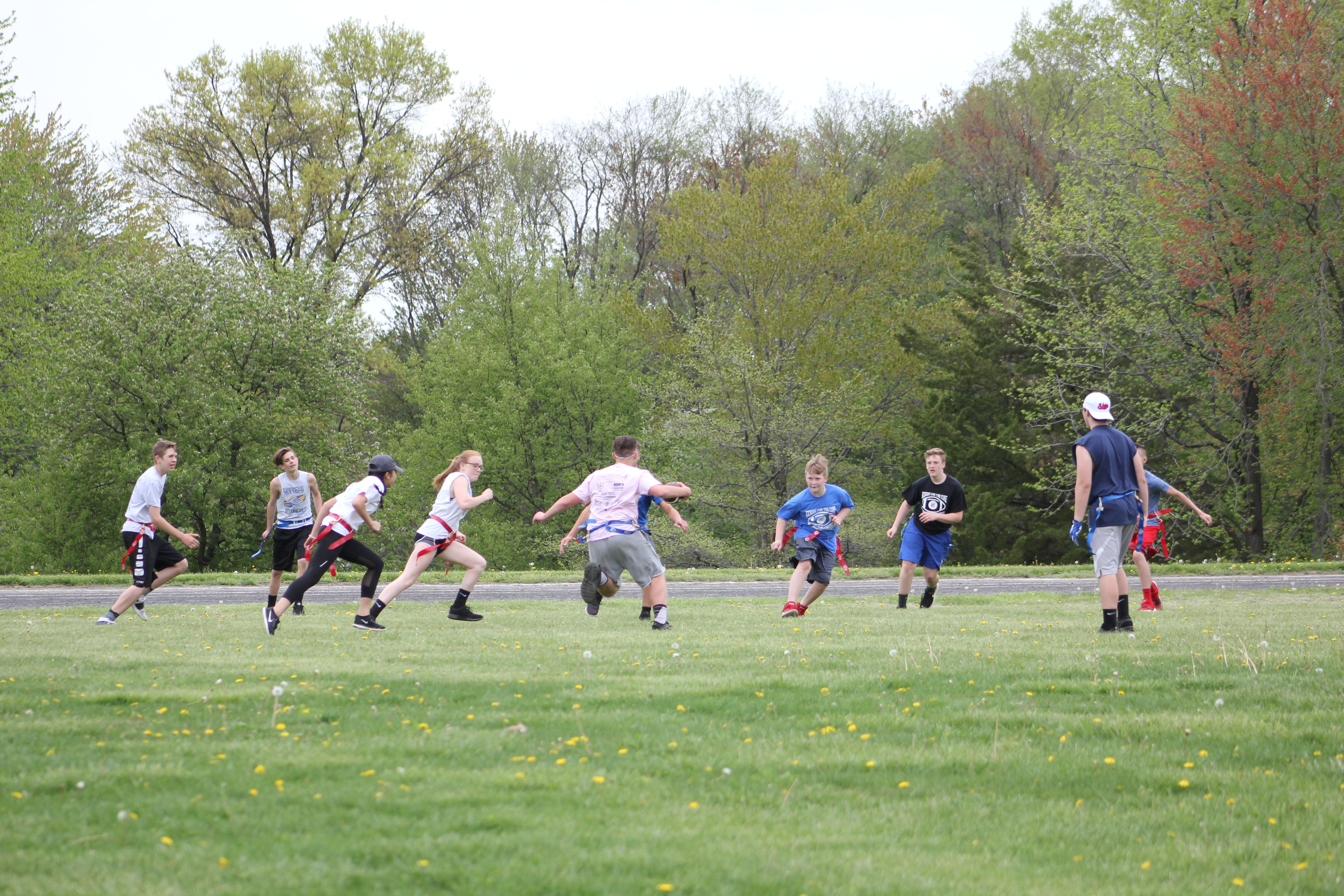 image of youth playing flag football